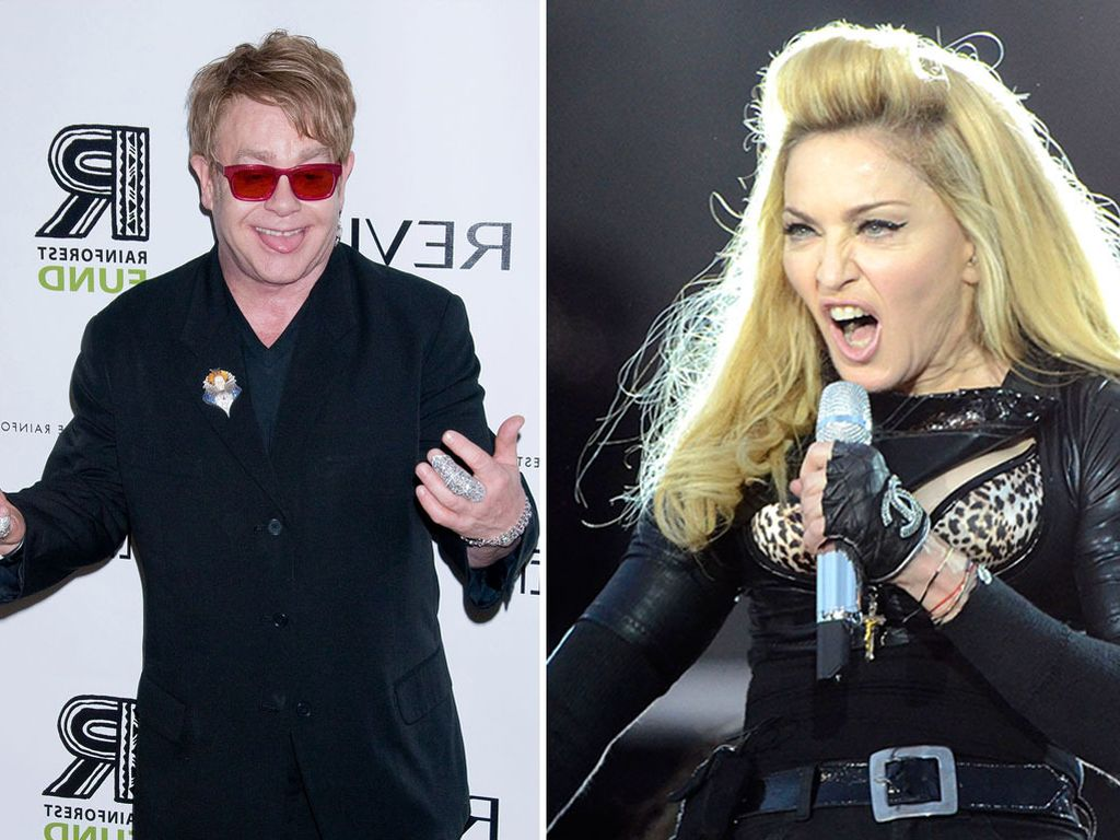 Elton John gestikuliert und Madonna guckt komisch