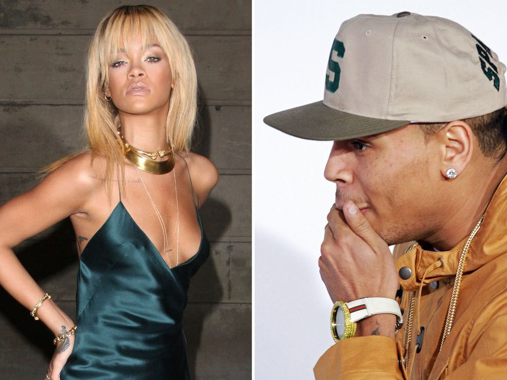 Rihanna sexy und Chris Brown mit Hand vor dem Mund