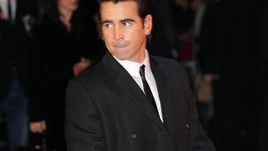 Colin Farrell schaut zur Seite im Anzug