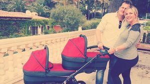 Jens büchner mit Daniela Karabas und zwei Kinderwagen