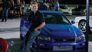 Pauk Walker mit blauem Auto