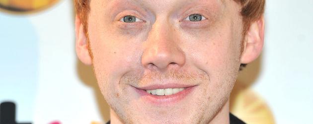 Rupert Grint lacht