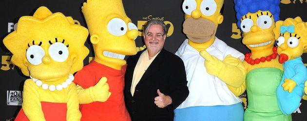 Simpson-Erfinder Matt Groening mit seinen Simpsons