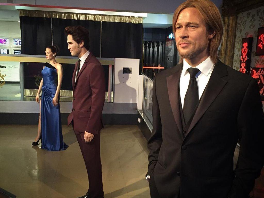 Die getrennten Wachsfiguren von Angelina Jolie und Brad Pitt bei Madame Tussauds in London