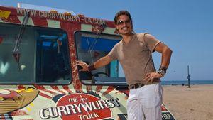 Currywurst-Mann Chris vor seinem Truck