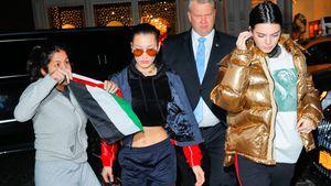 Bella Hadid und Kendall Jenner und ein übereifriger Fan (links im Bild)