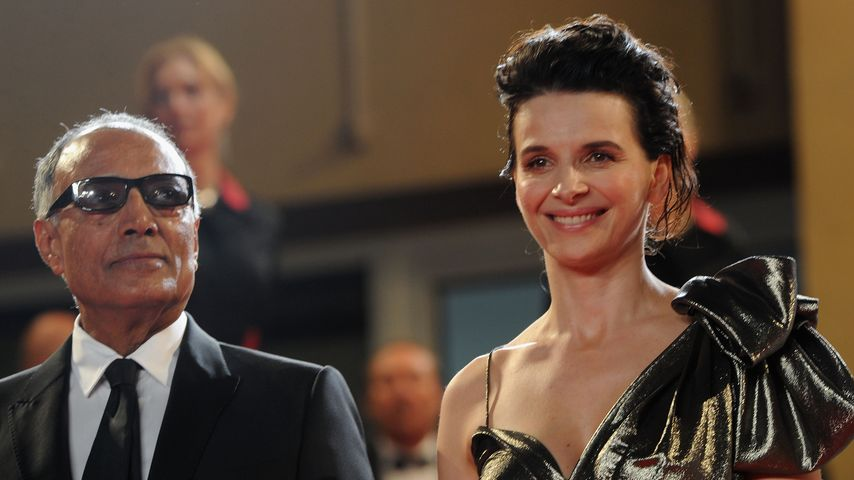 "Abbas Kiarostami mit Juliette Binoche bei der ""Certified Copy""-Premiere in Cannes 2010"