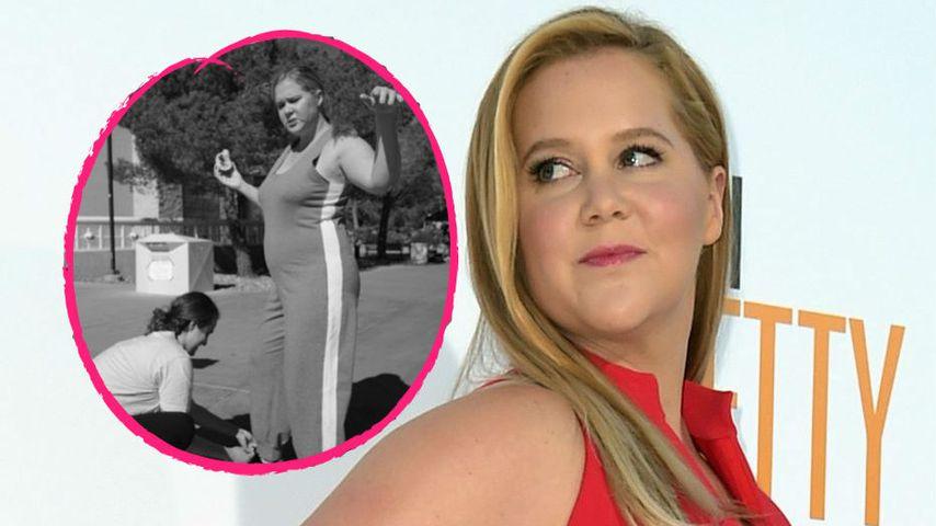Mega-schwangere Amy Schumer kann Schuhe nicht selber binden