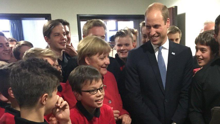 Angela Merkel und Prinz William während eines Empfangs in Düsseldorf