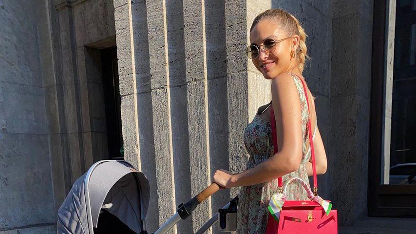 Ann-Kathrin Götze mit ihrem Nachwuchs, Juli 2020