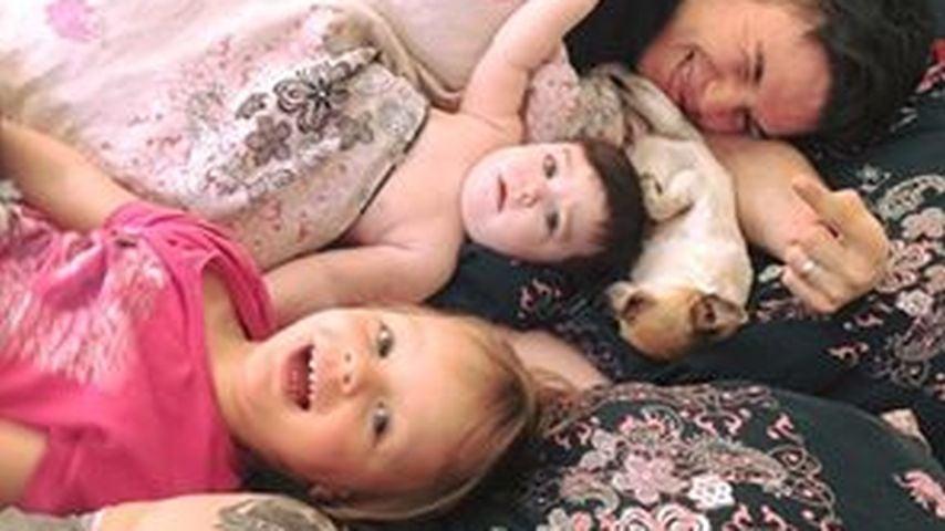 Anne Wünsche mit ihren zwei Töchtern, Henning und seiner großen Tochter