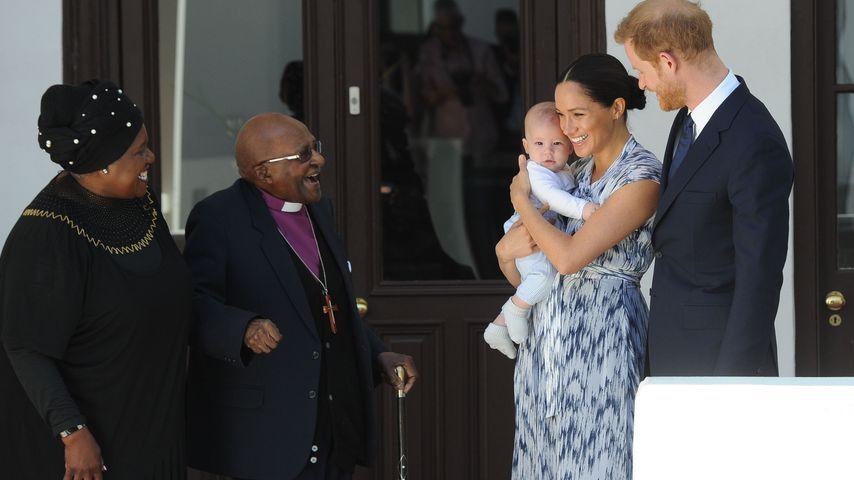 Erzbischof Desmond Tutu mit seiner Tochter und Herzogin Meghan mit Archie und Prinz Harry