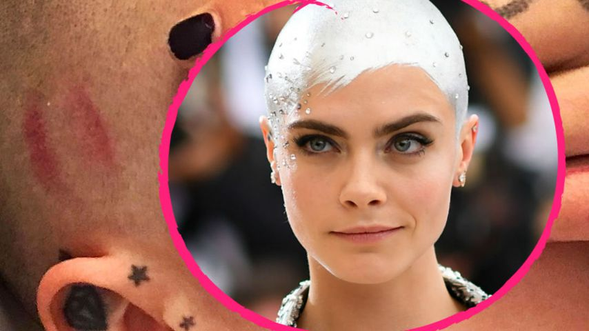 Verdächtiger Kussmund auf Glatze: Wer hat Cara geknutscht?