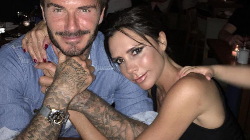 David Beckham und Victoria Beckham in einer Bar