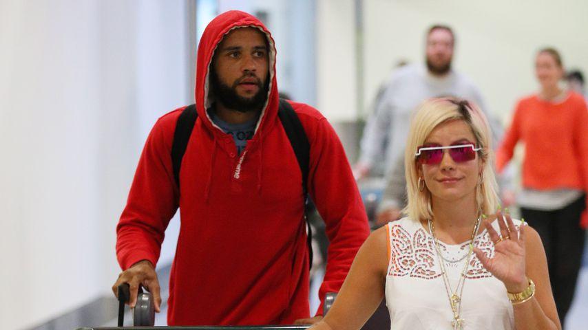 DJ Meridian Dan und Lily Allen am Flughafen in Sydney