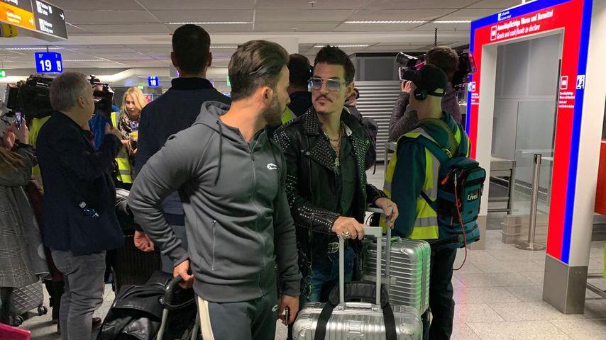 Domenico De Cicco und Chris Töpperwien am Frankfurter Flughafen
