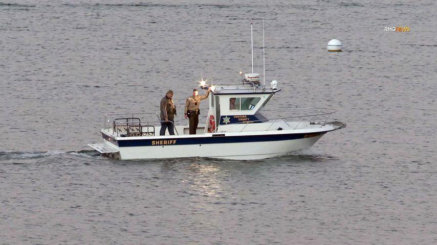 Ein Suchtrupp auf dem Piru-See