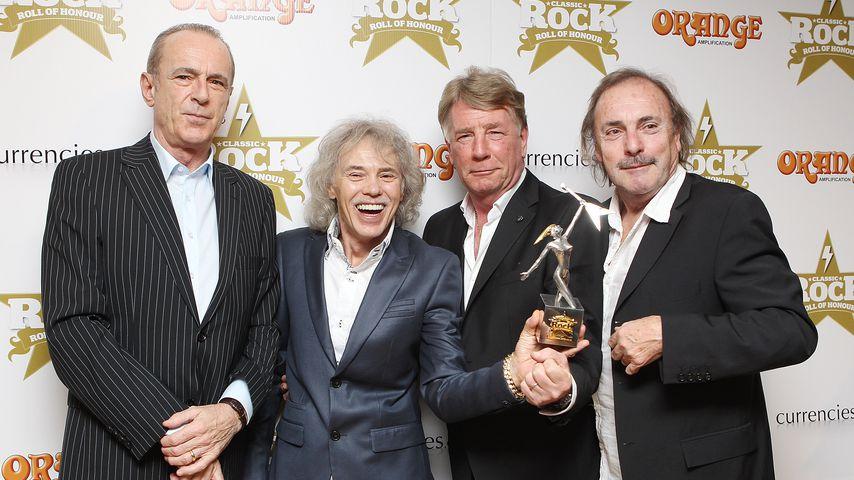Francis Rossi, Alan Lancaster, Rick Parfitt und John Coghlan von der Band Status Quo, 2012