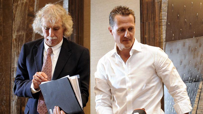 Johannes Peil und Michael Schumacher im Jahr 2009