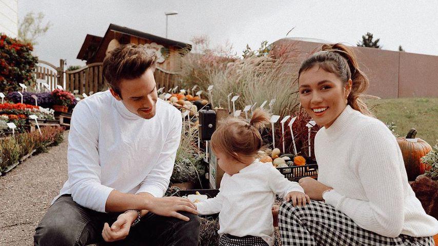 Julian Gutjahr und Anna Maria Damm mit ihrer Tochter Eliana