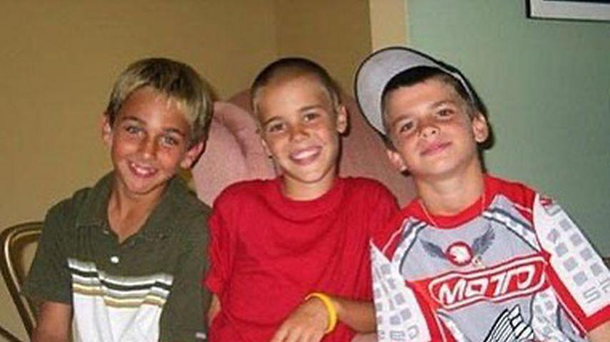 Justin Bieber mit zwei Freunden
