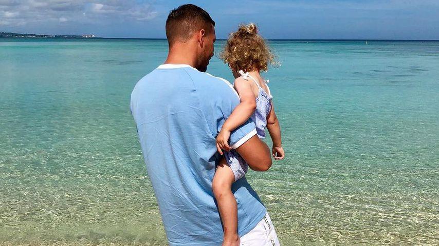 Lukas Podolski mit seiner Tochter Maya