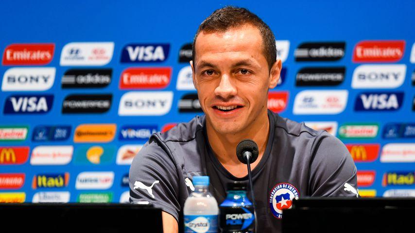 Marcelo Diaz bei einer Pressekonferenz 2014