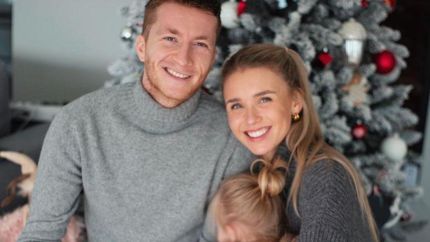 Marco Reus mit seiner Frau Scarlett und seiner Tochter