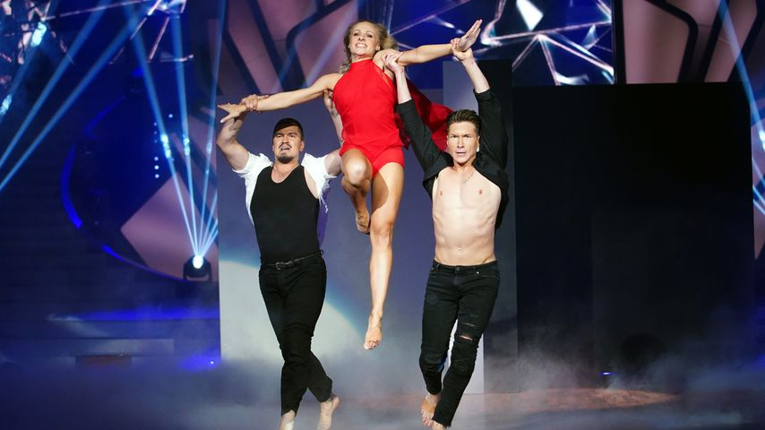 Marta Arndt mit Evgeny Vinokurov und Evgenij Voznyuk