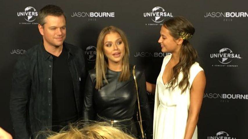 Matt Damon, Kim Gloss und Alicia Vikander im Juli 2016