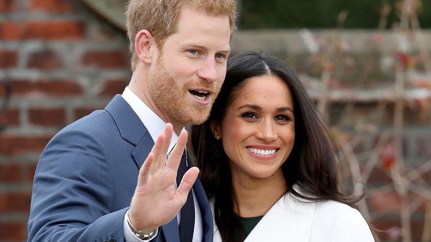 Prinz Harry und Meghan Markle in den Gärten des Kensington Palastes