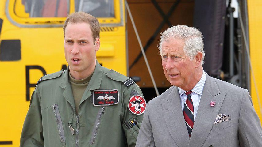 Prinz William und Prinz Charles im Juli 2012