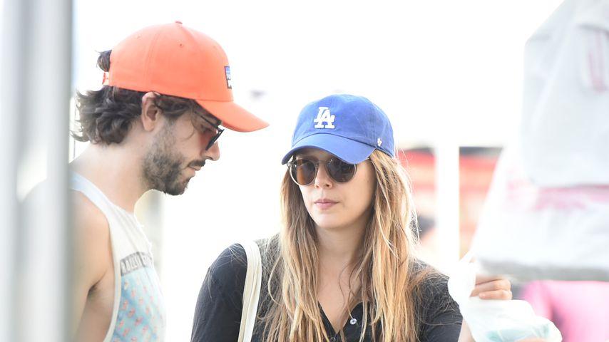 Robbie Arnett und Elizabeth Olsen, Oktober 2017