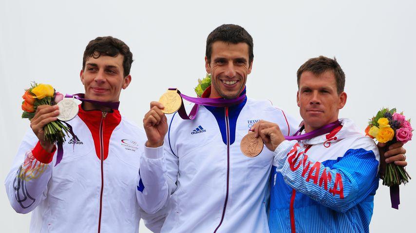 Sideris Tasiadis (l.), Tony Estanguet (m.) und Michal Martikan