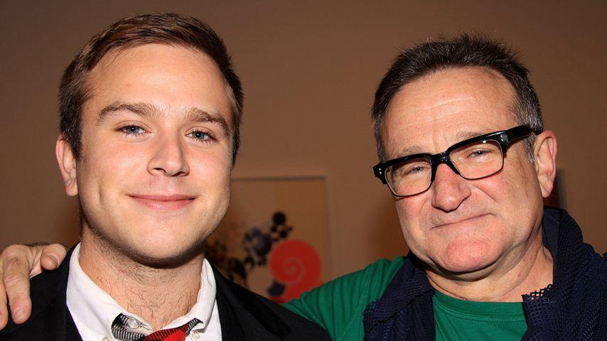 Zachary Pym und Robin Williams im November 2011
