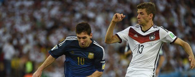 Thomas Müller und Lionel Messi
