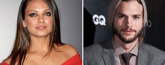 Mila Kunis in einem roten Kleid und Ashton Kutcher mit Mütze