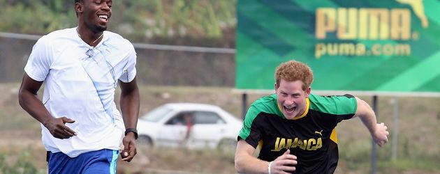 Prinz Harry beim Training mit Usain Bolt